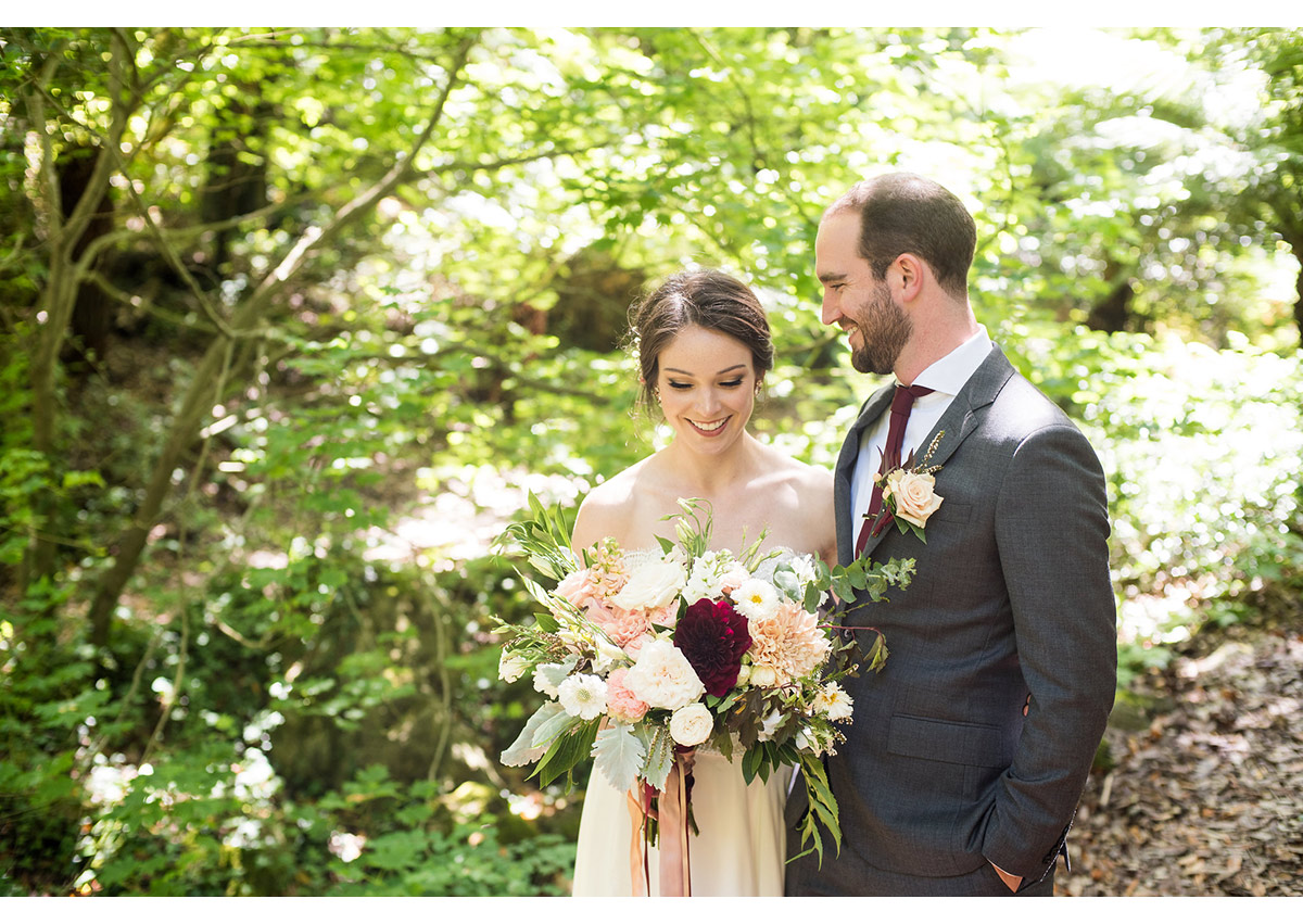 Candid photo of bride and groom in woods