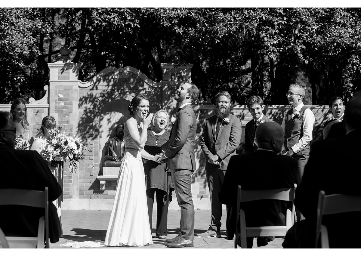 Bride and groom laughing at Shakespeare Garden wedding ceremony