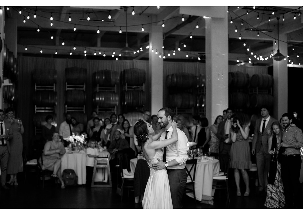 Black and white of bride and groom's first dance at Dogpatch Wineworks