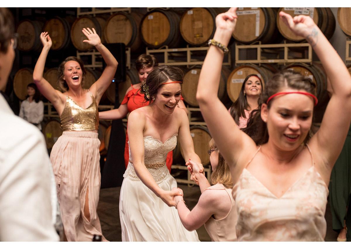 Candid photo of bride dancing