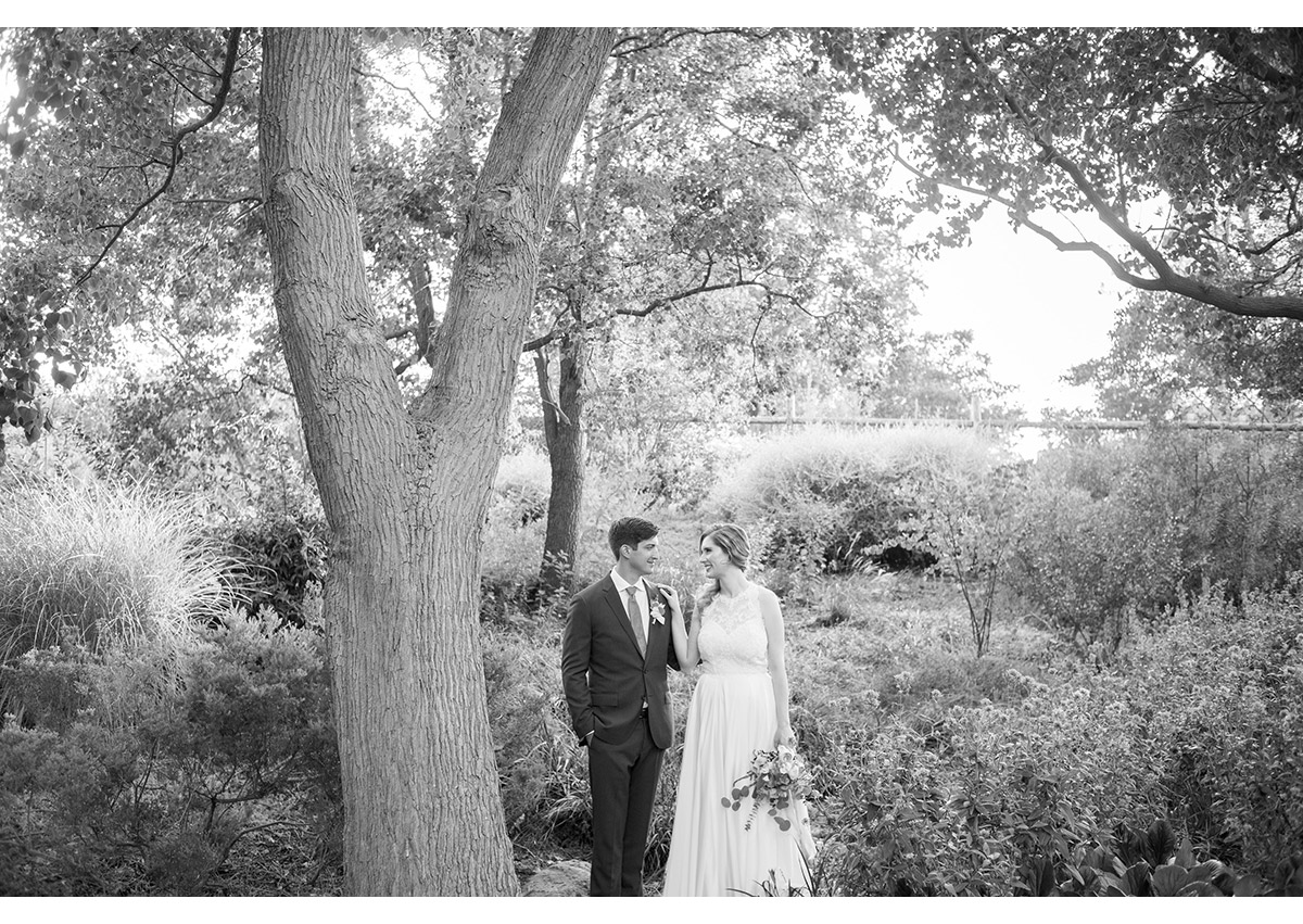 Black and white of bride and groom in garden