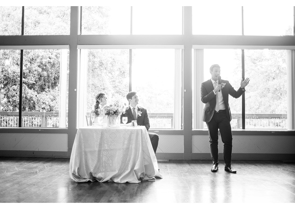 Best man giving toast during wedding reception at Heather Farm
