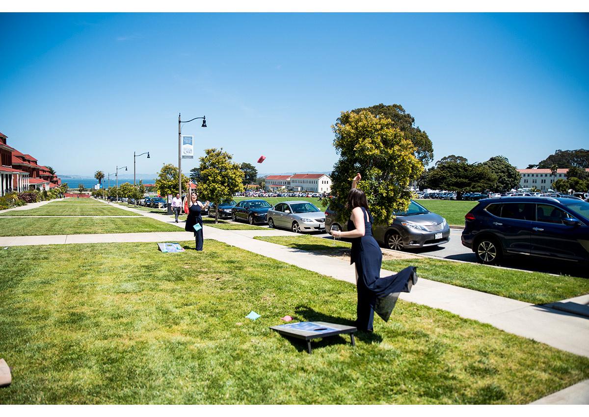 Bridesmaids playing cornhole at SF Commissary