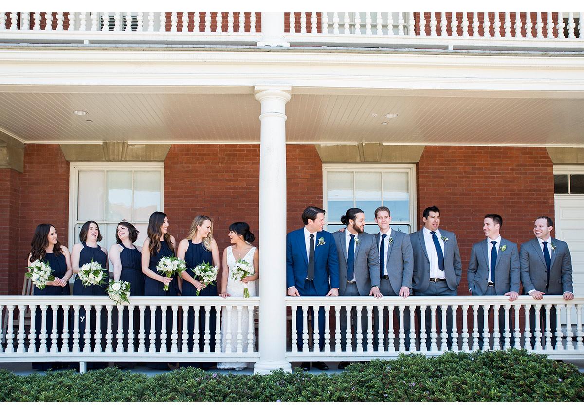 Wedding party on balcony of Inn at the Presidio