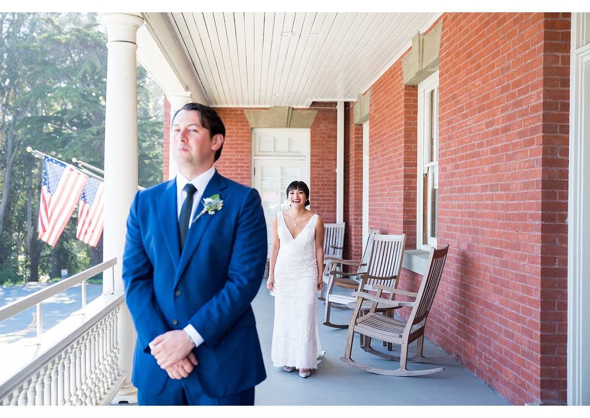 Bride and groom during first look on Presidio balcony