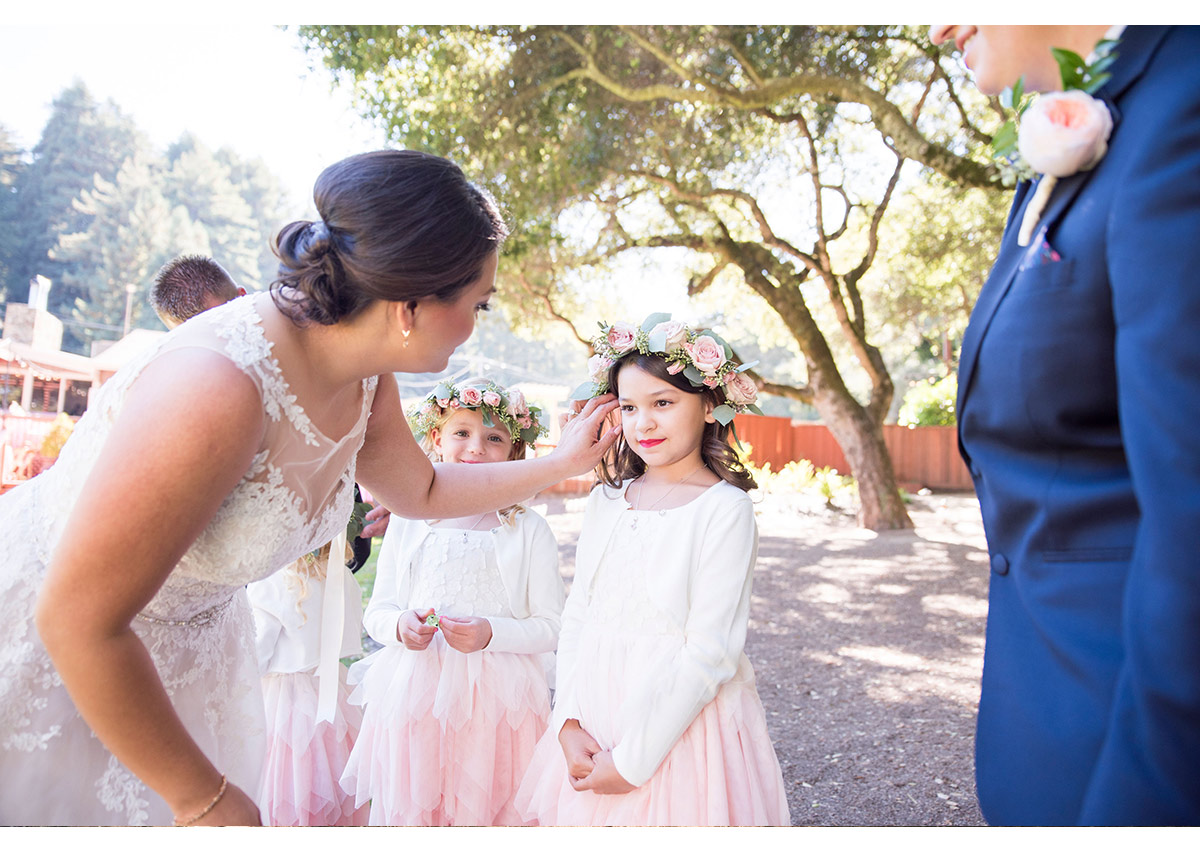 Bride assisting flower girl