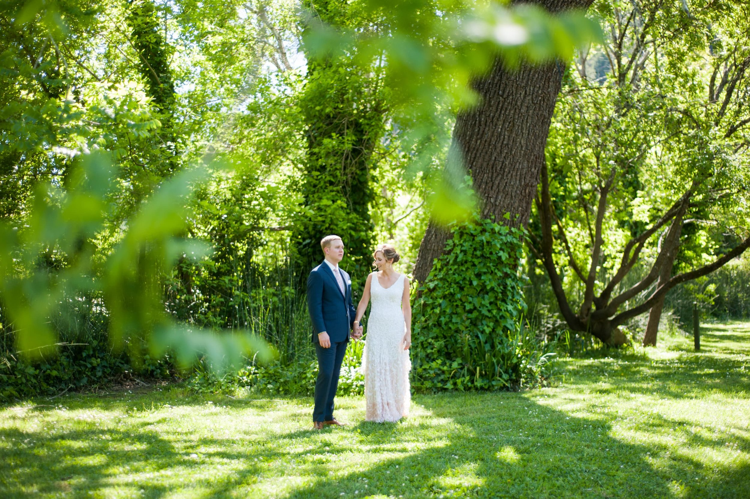 Bride and Groom surrounded by lush greenery in Guerneville
