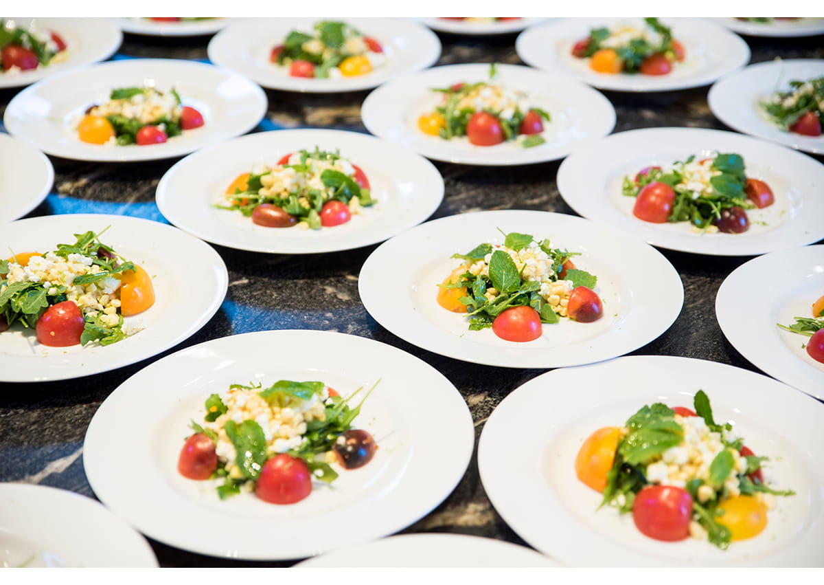Plates of salad ready to be served