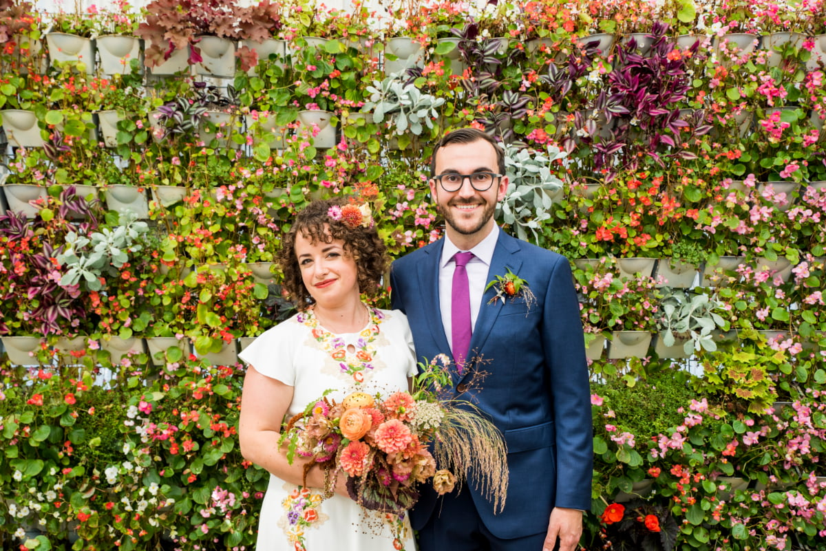 Bride and Groom in front of living wall at Shelldance
