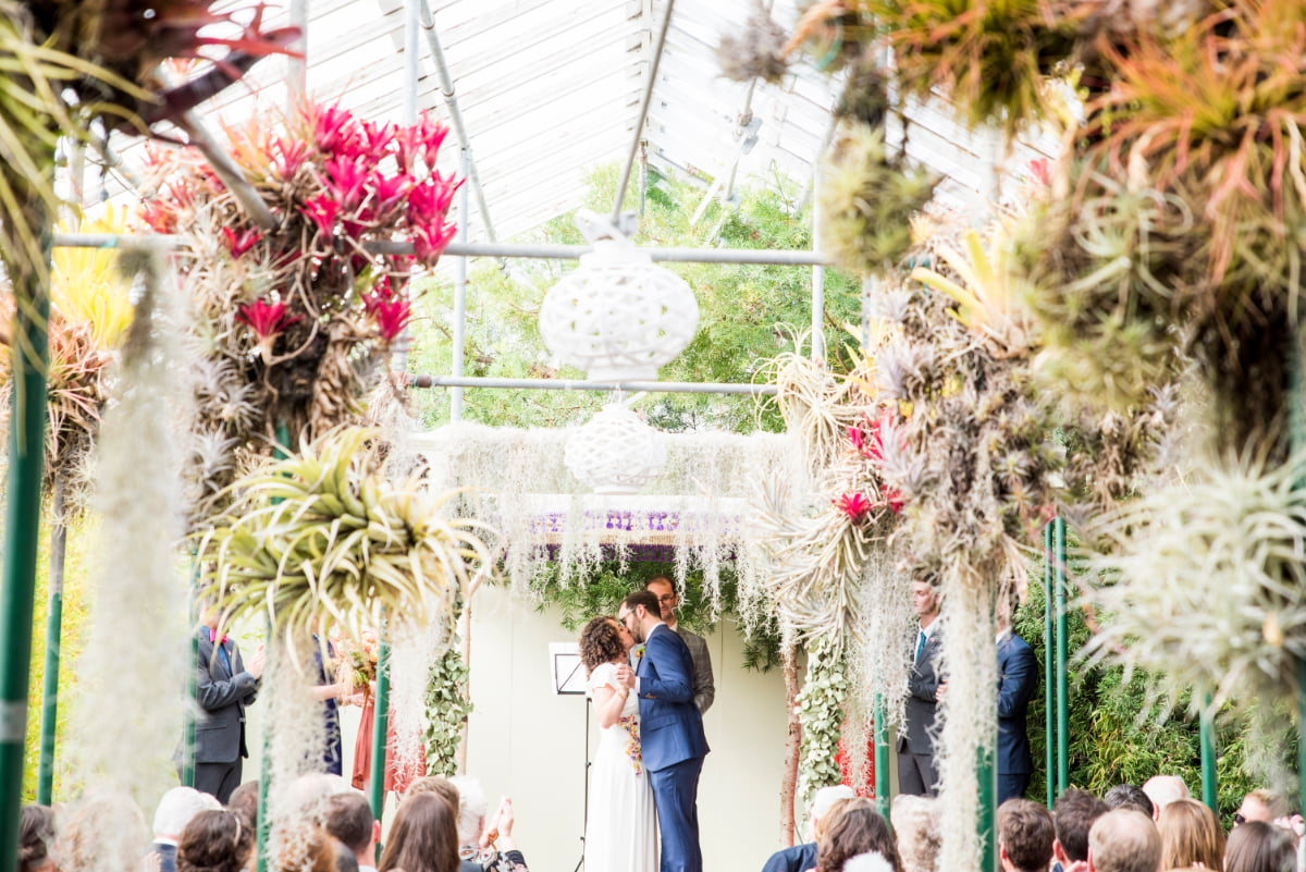 Bride and Groom kiss at Shelldance Orchid Garden wedding