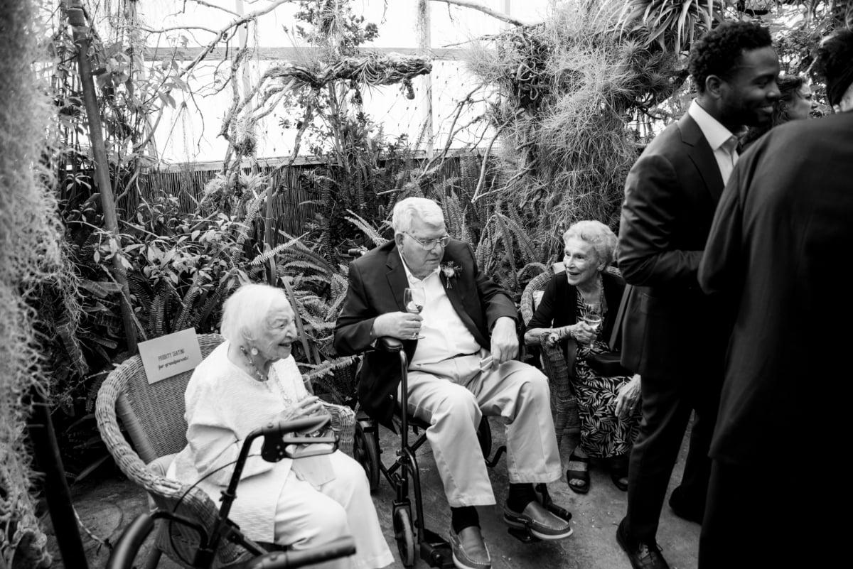 Grandparents during wedding reception at Shelldance Orchid Gardens
