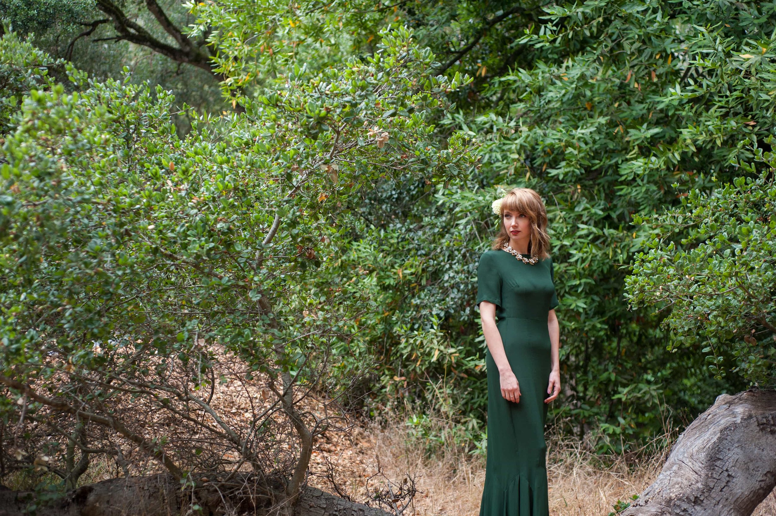 Portrait of bride in green wedding dress in Tilden Park