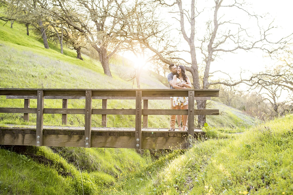 Engaged couple on wooden bridge in East Bay hills