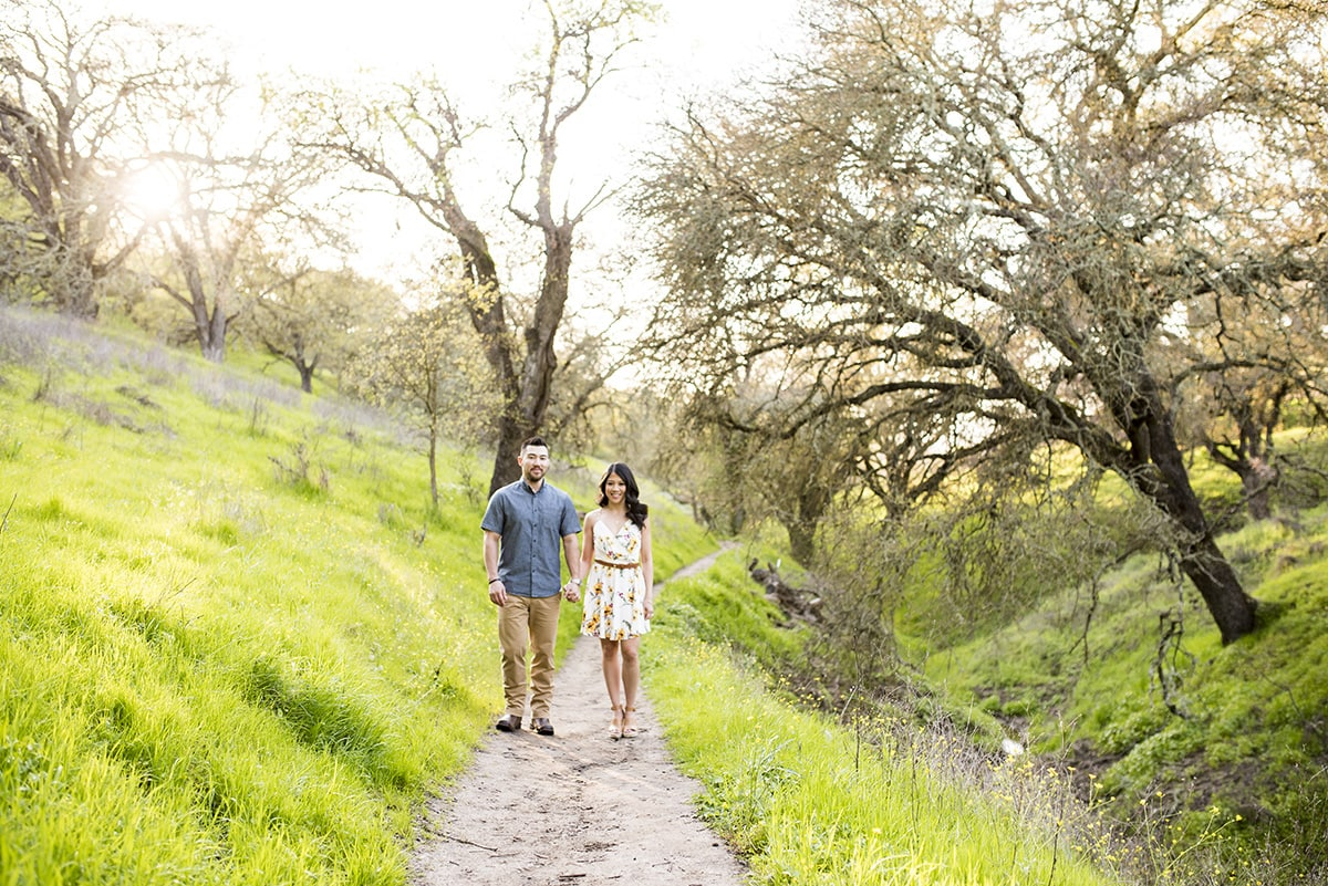 Couple standing on hiking trail holding hands