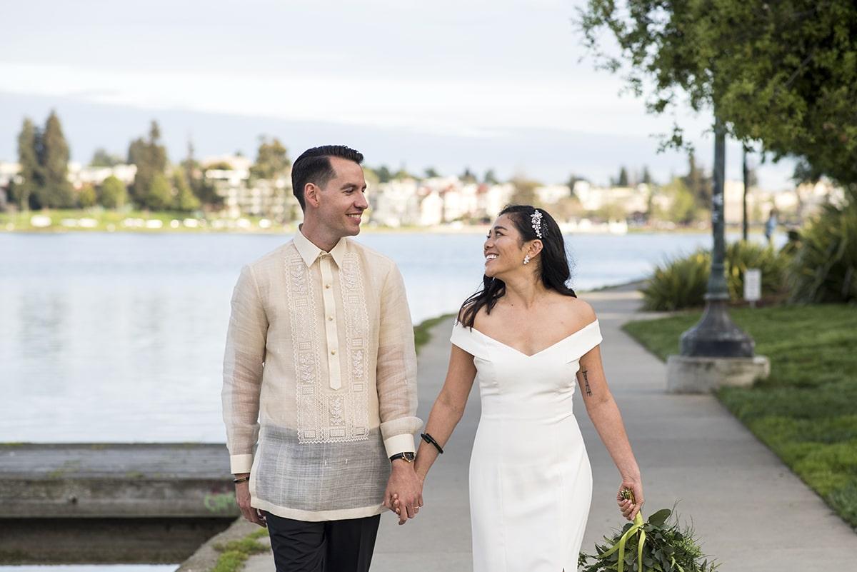Just married couple walking along Lake Merritt