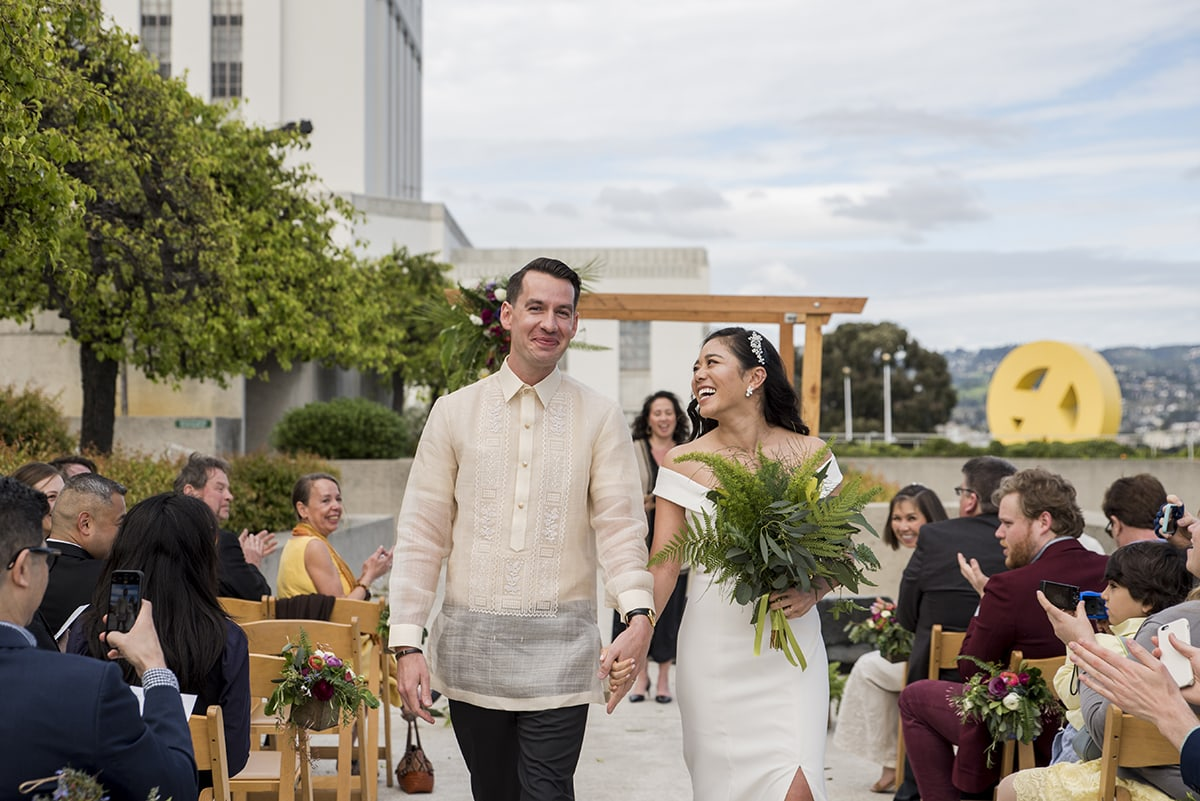 Bride and Groom walking down aisle after wedding ceremony in Oakland
