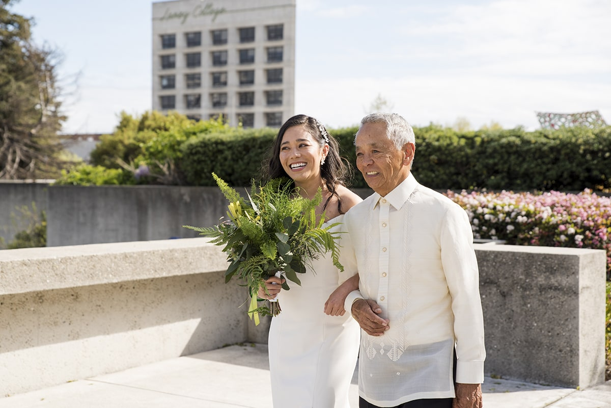 Bride walking down aisle with father at Oakland Museum wedding