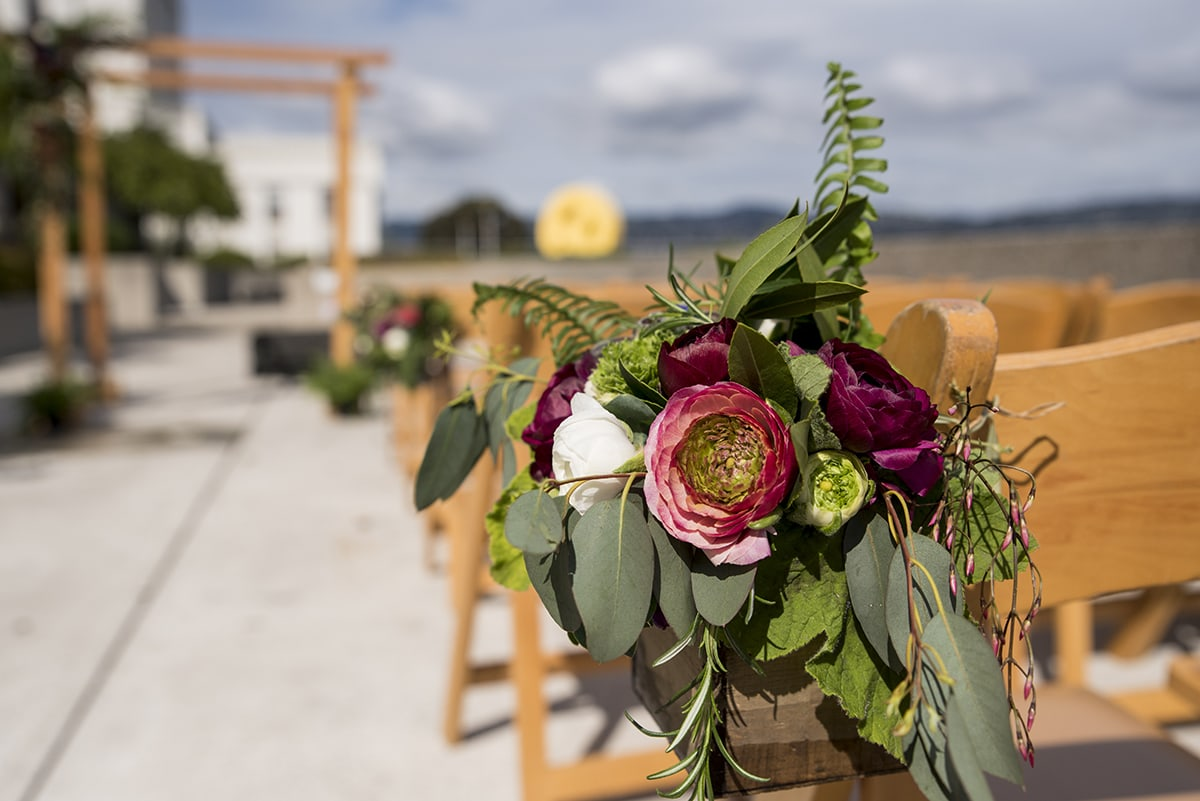 Flower arrangement on ceremony chairs at Oakland Museum of California