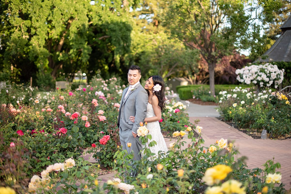 Bride and Groom standing in the rose garden at Heather Farm in Walnut Creek