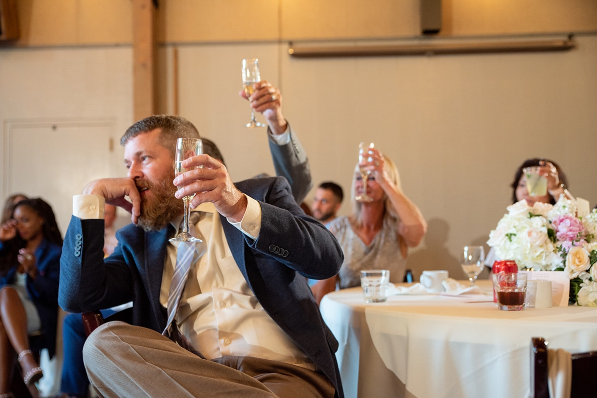 Wedding guest raising his champagne glass