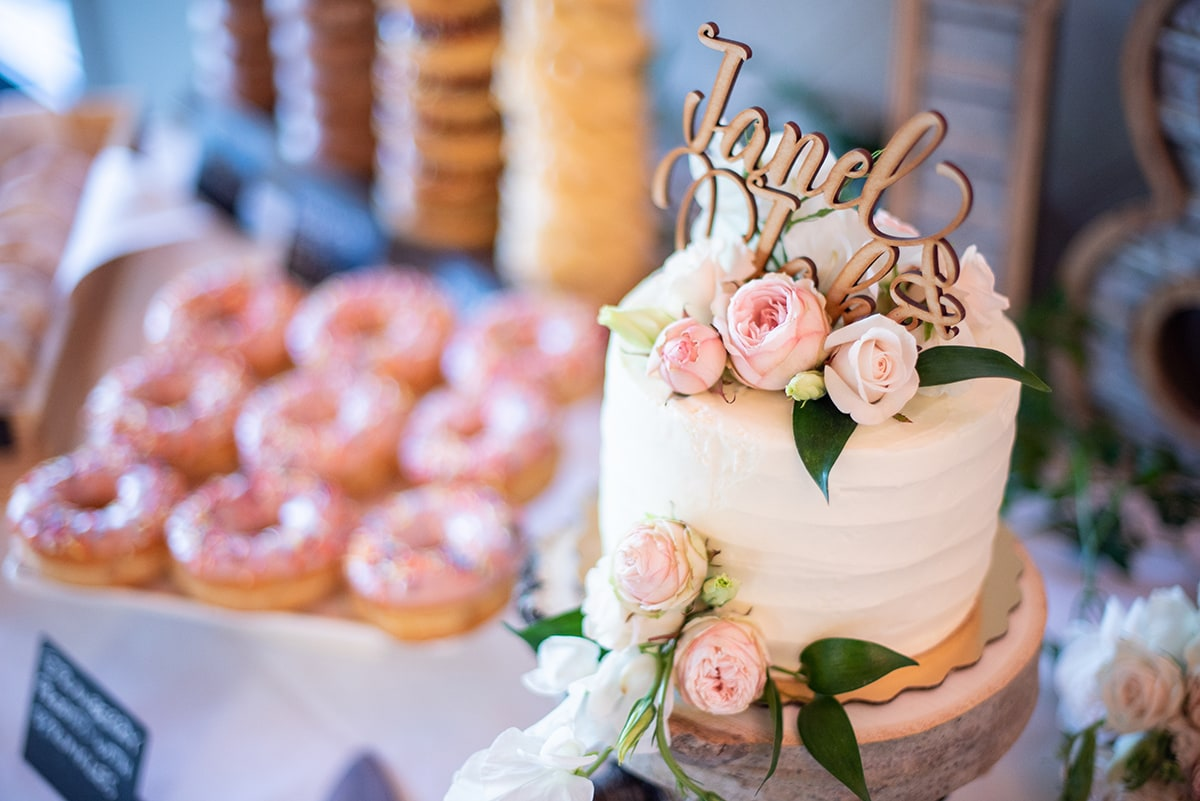 Wedding cake and donuts at reception in Walnut Creek
