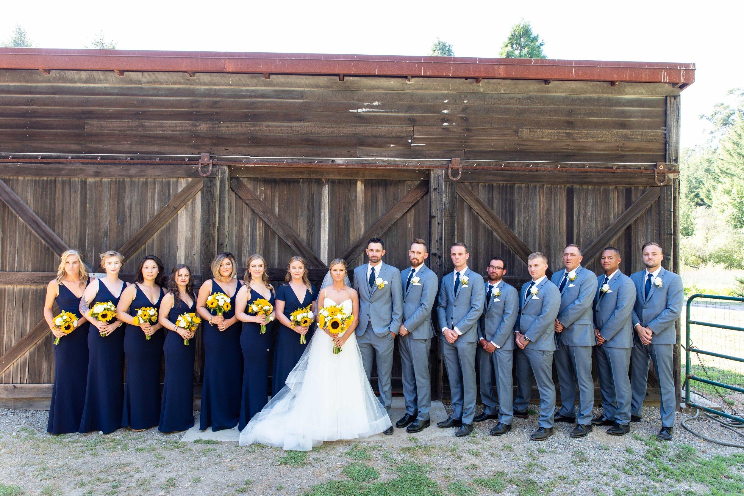 Rustic barn wedding party photo