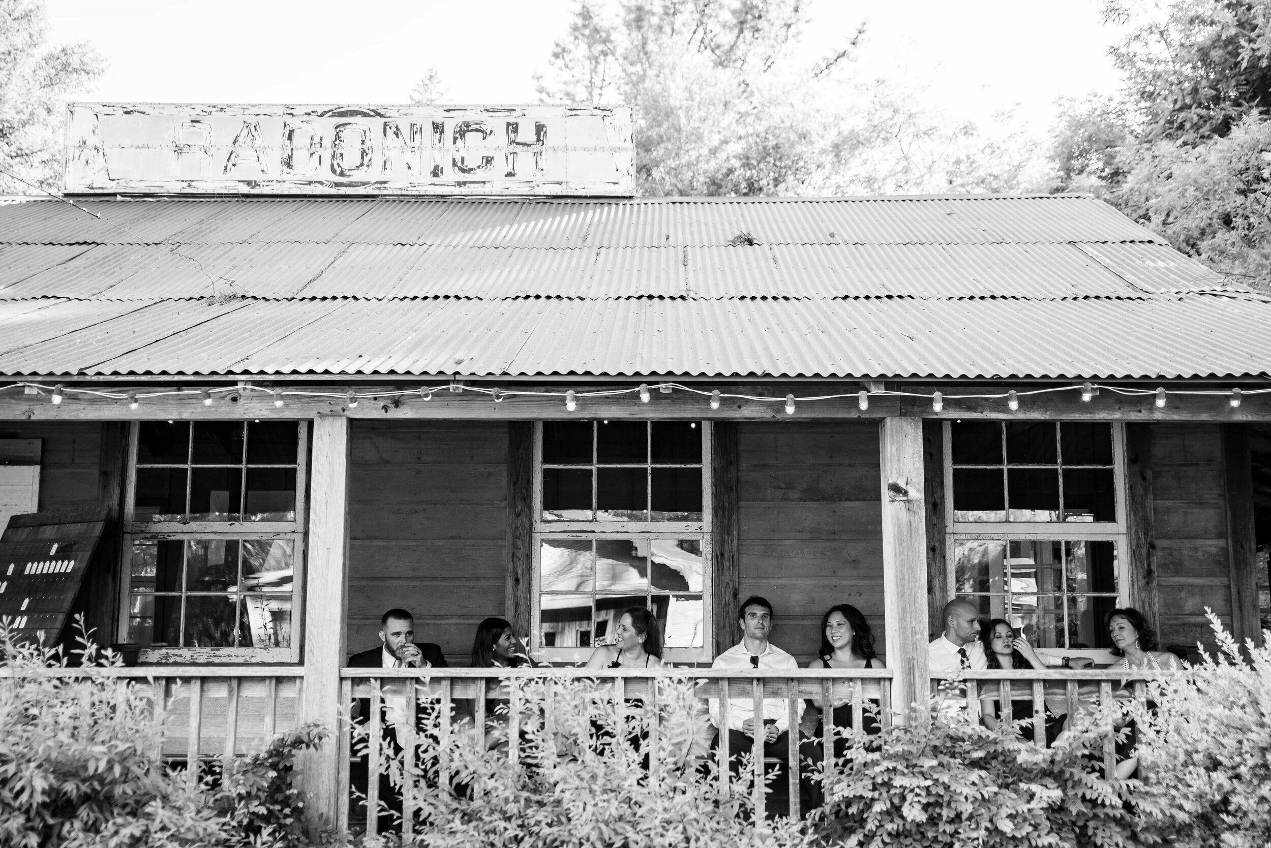 Black and white of wedding guests at Radonich Ranch