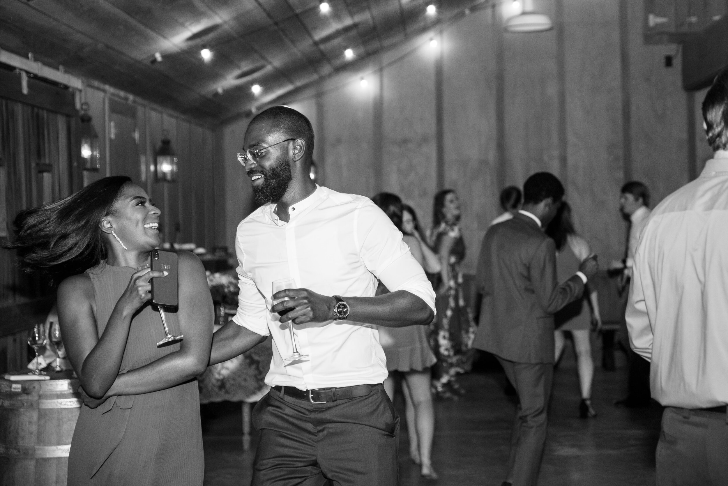 Wedding guests dancing in barn at Radonich Ranch