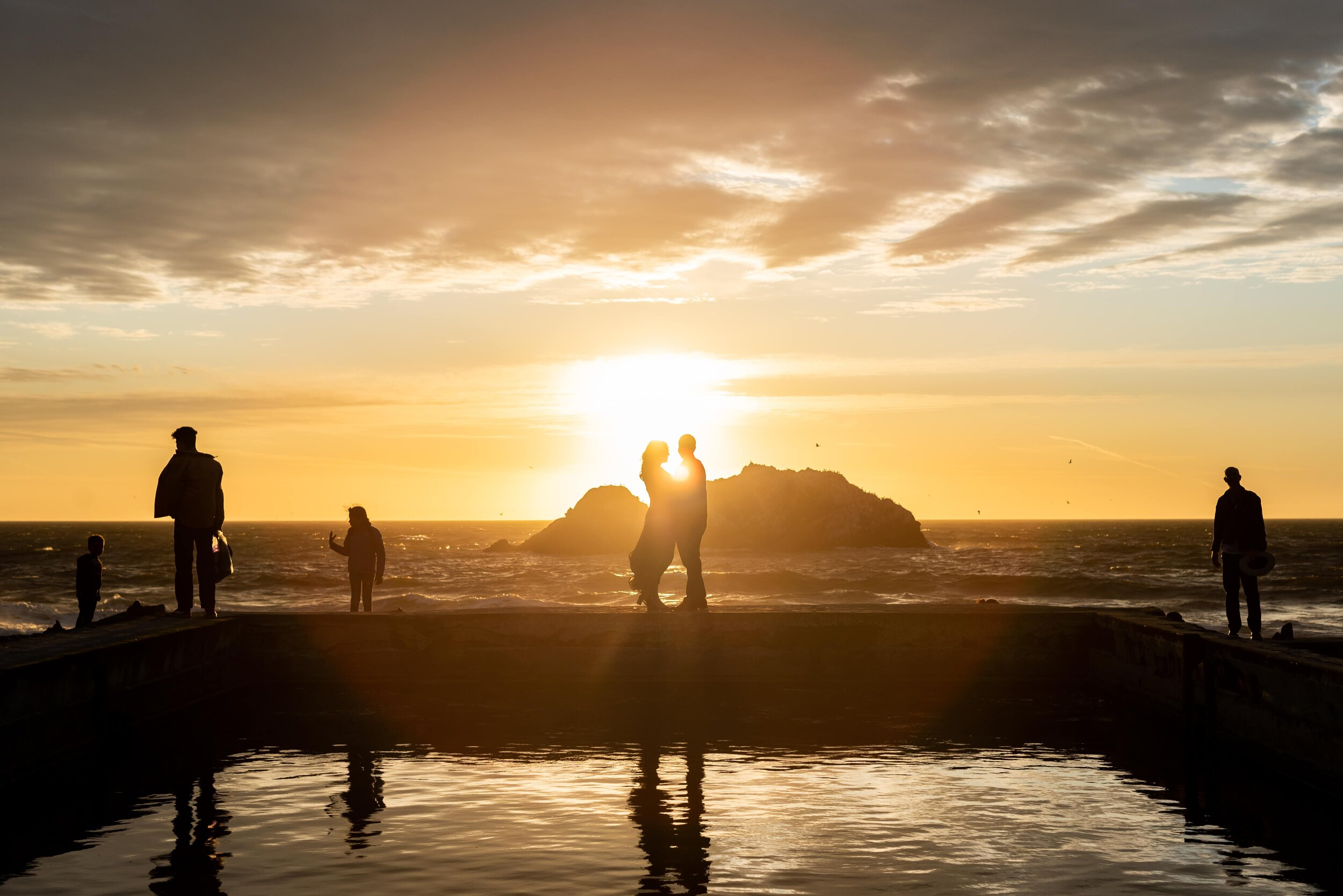 Silhouette of couple and people at sunset at Sutro Baths