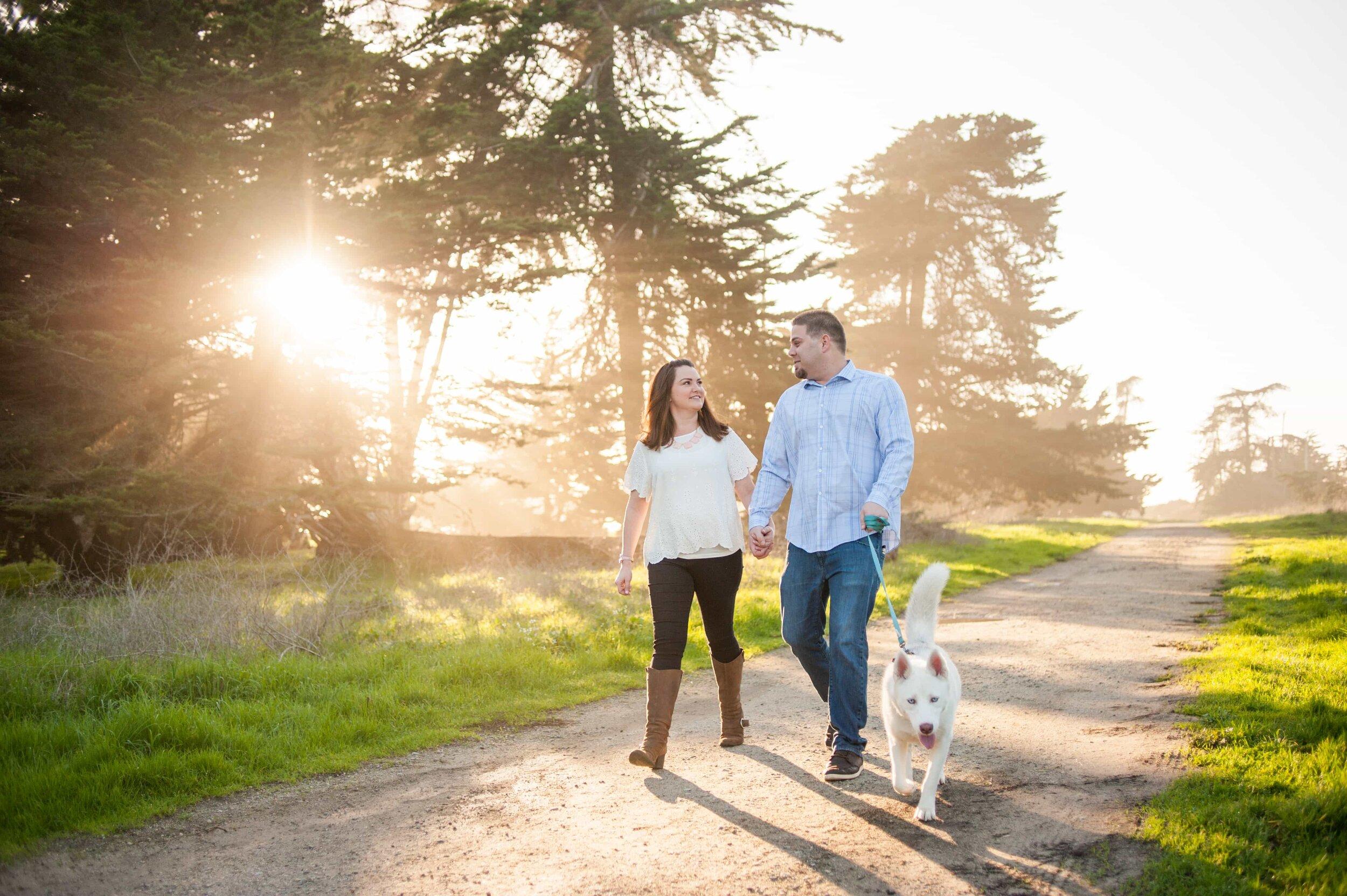 Couple walking dog during engagement session in Santa Cruz