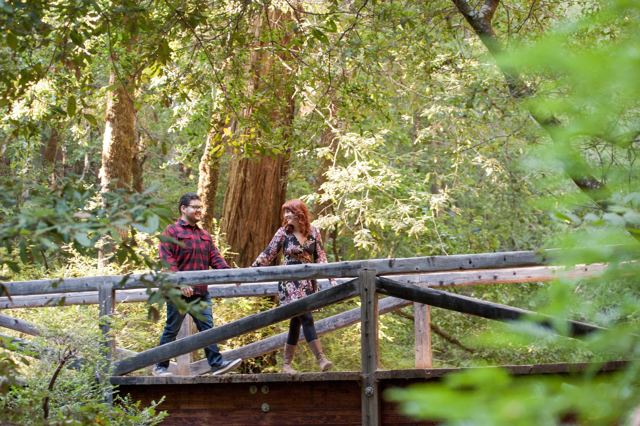 Couple walking on wooden bridge at Big Basin State Park