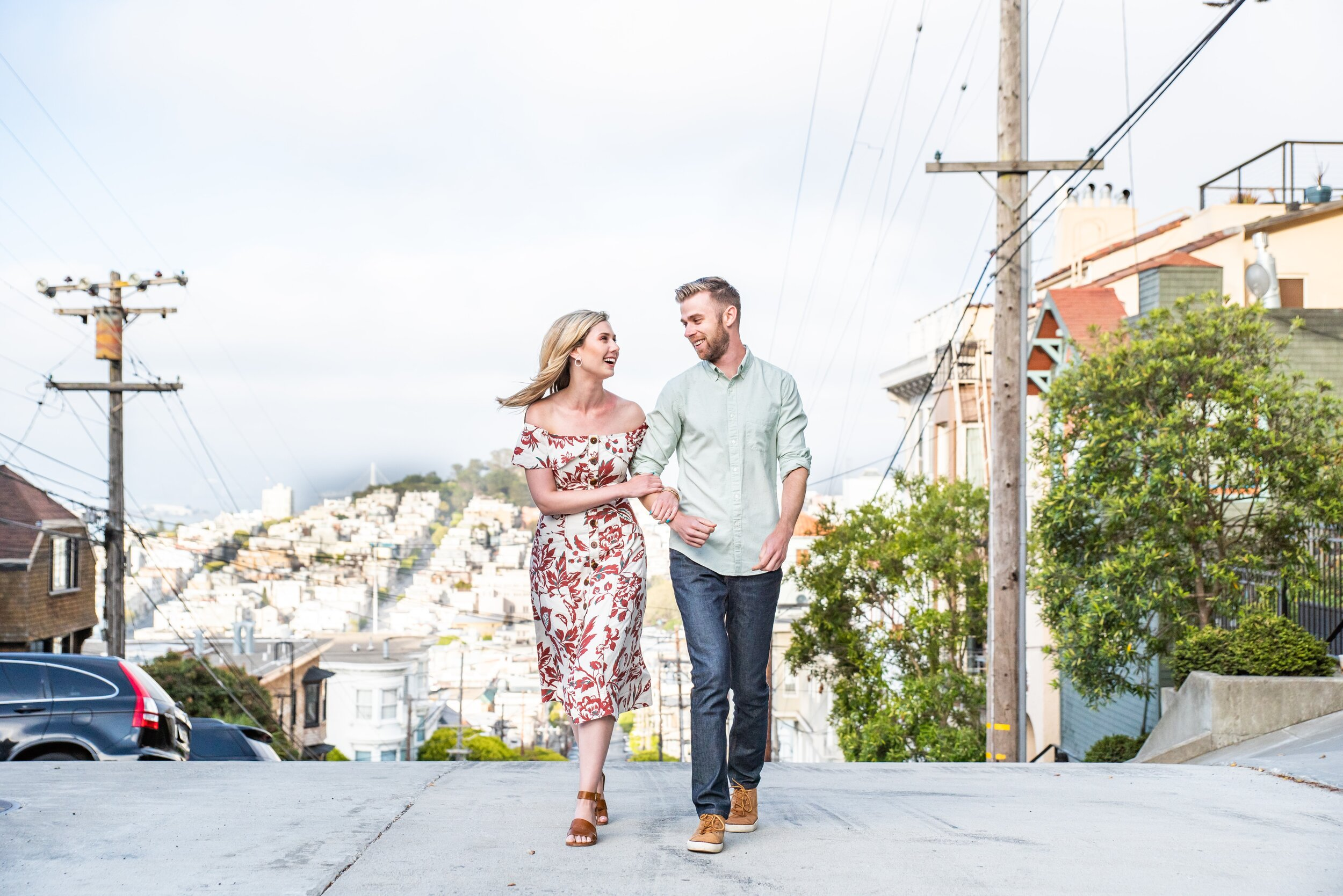 Newly engaged couple walking on Russian Hill in SF