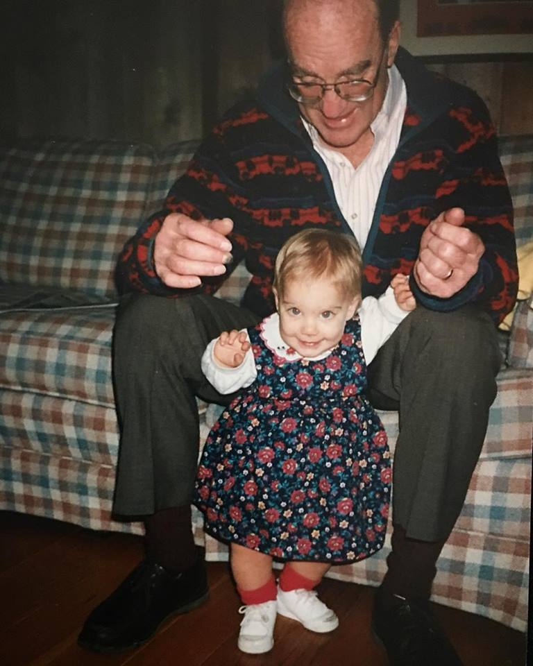 Julia learning to walk with Grandpy wearing his fleece.