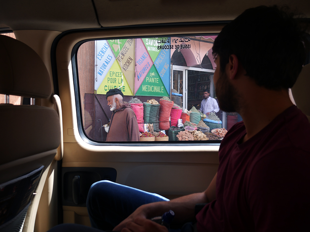 emily baker marrakech man through window.jpg