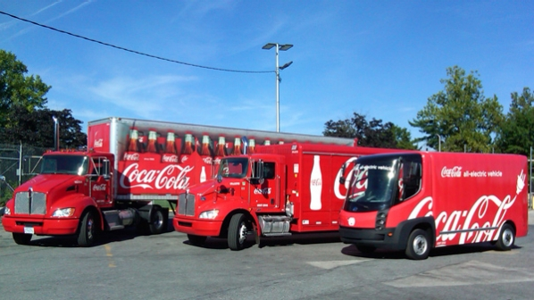 The new fleet of hybrid Coca-Cola delivery trucks, intended to reduce the brand's carbon footprint. Photo courtesy of the  Coca-Cola Company .