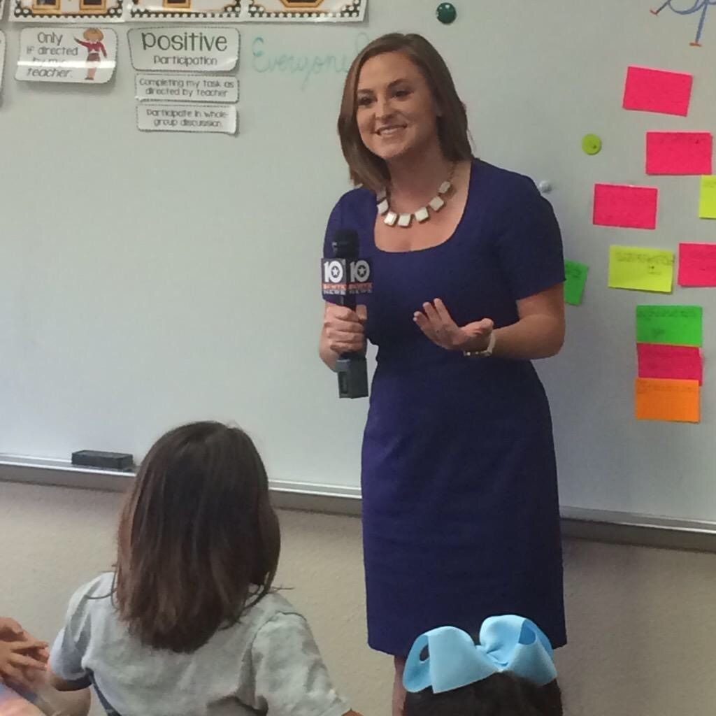 Media Specialist  Bethany Moore  covering a story in her previous job as a broadcast reporter.