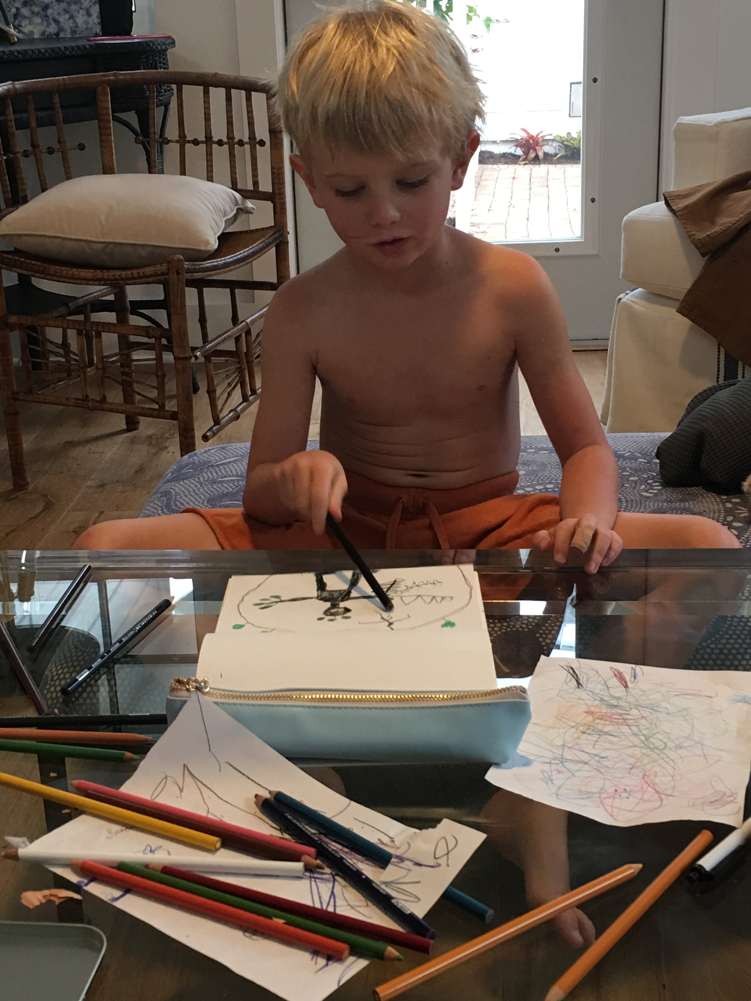 Joah narrating his story to Gramma as he drew.