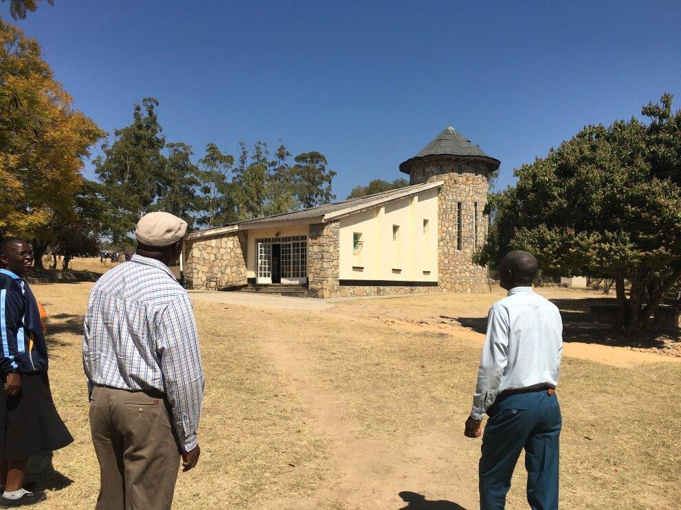 Charles Kaguda, HoH National Director, and Pastor Nyemba visiting the school chapel.