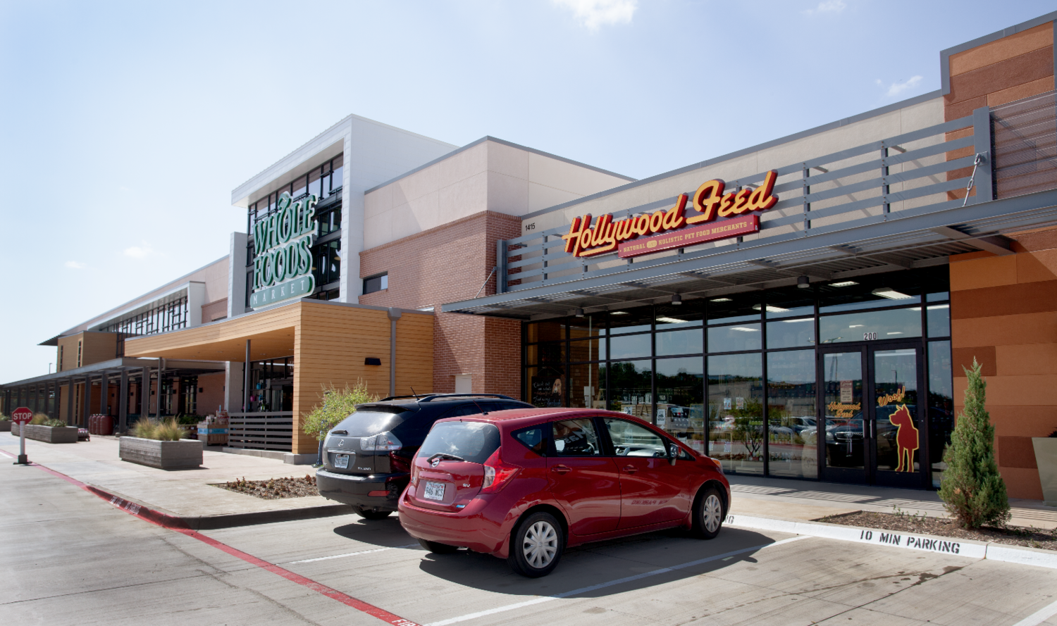 Exterior signage design and storefront decals for Hollywood Feed location in Dallas, TX