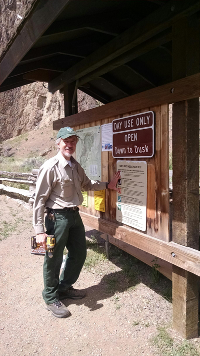 Smith Rock Ranger Scott Brown and Smith Rock Needs Your Help signage