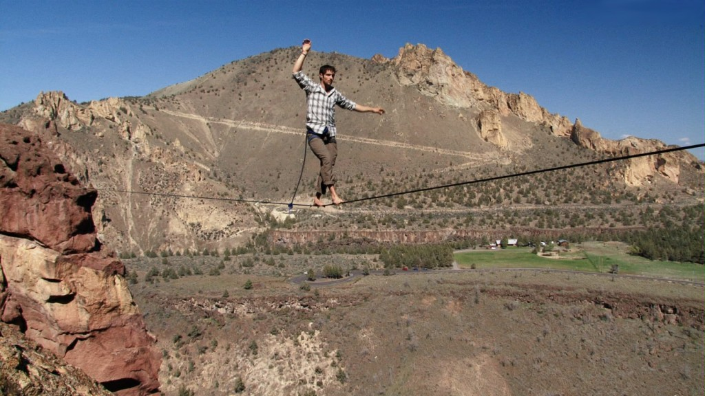 slackliner on Where Swallows Fly highline at Smith Rock State Park