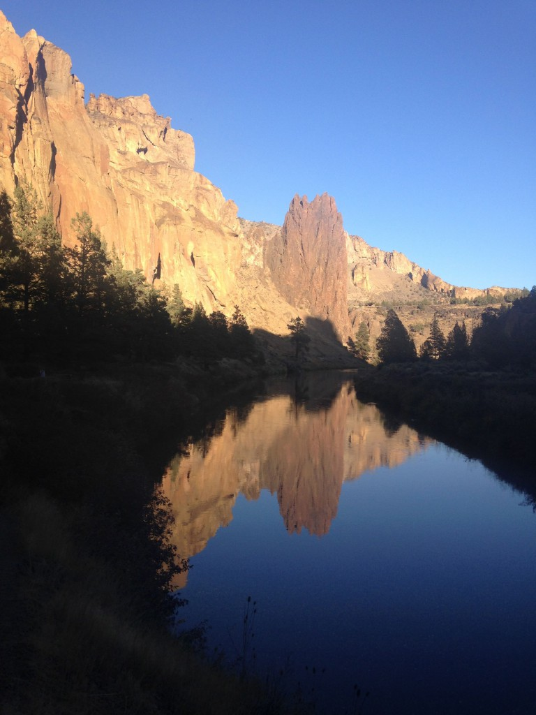 Welded tuff rock spires at Smith Rock State Park reflecting on the Crooked River