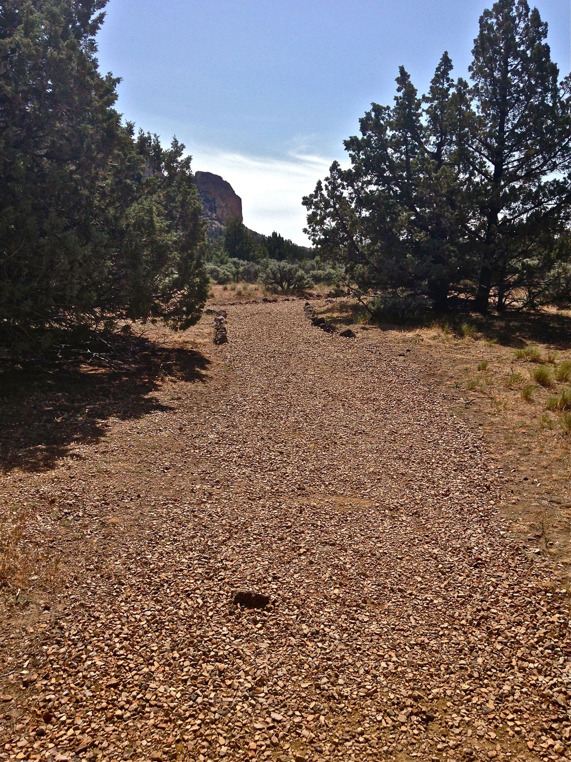 Final gravel path at the end of the Homestead Trail coming out of the park canyon onto the Northern Point of Smith Rock State Park.