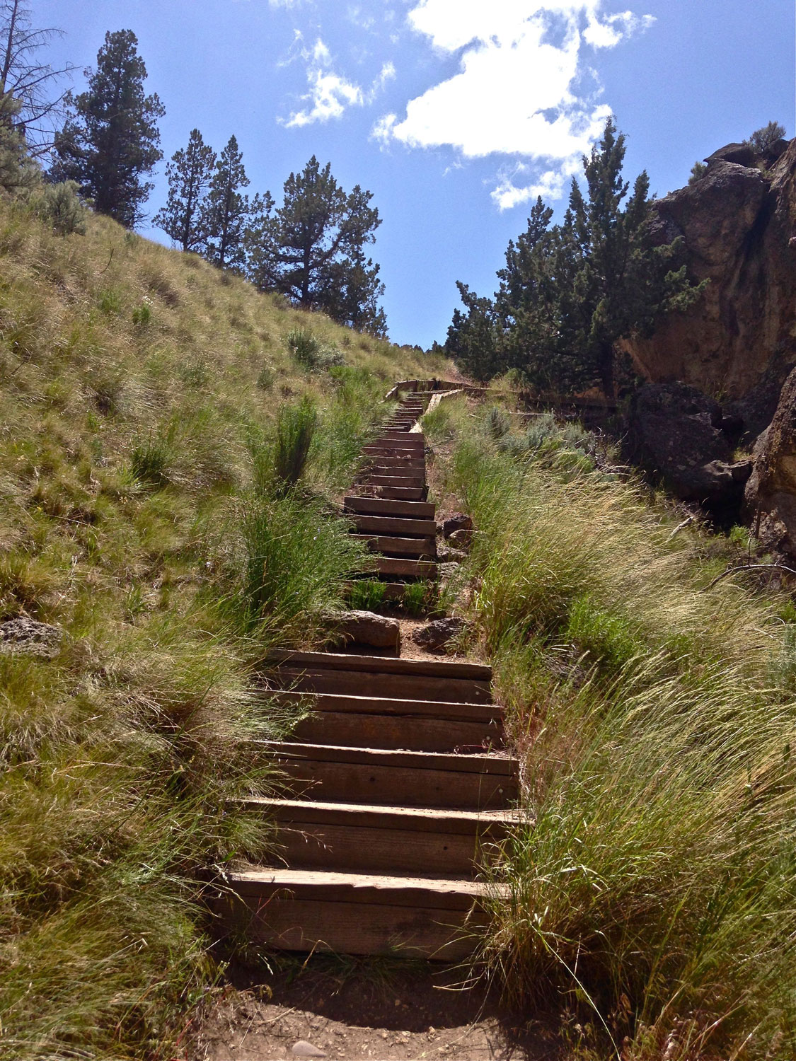 Scree trails yield to more stairs as the Rope-de-Dope Trail continues up to the top of the canyon at Smith Rock State Park.