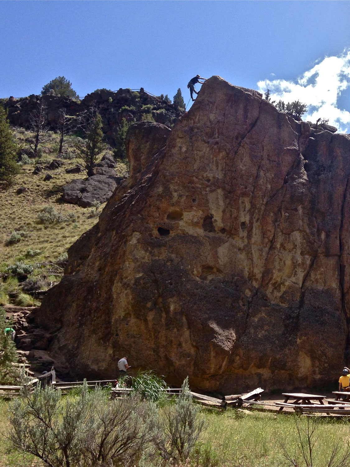 The start of the Rope-de-Dope Trail emerges to the left of the giant climbing rock block that bears its name at Smith Rock State Park.