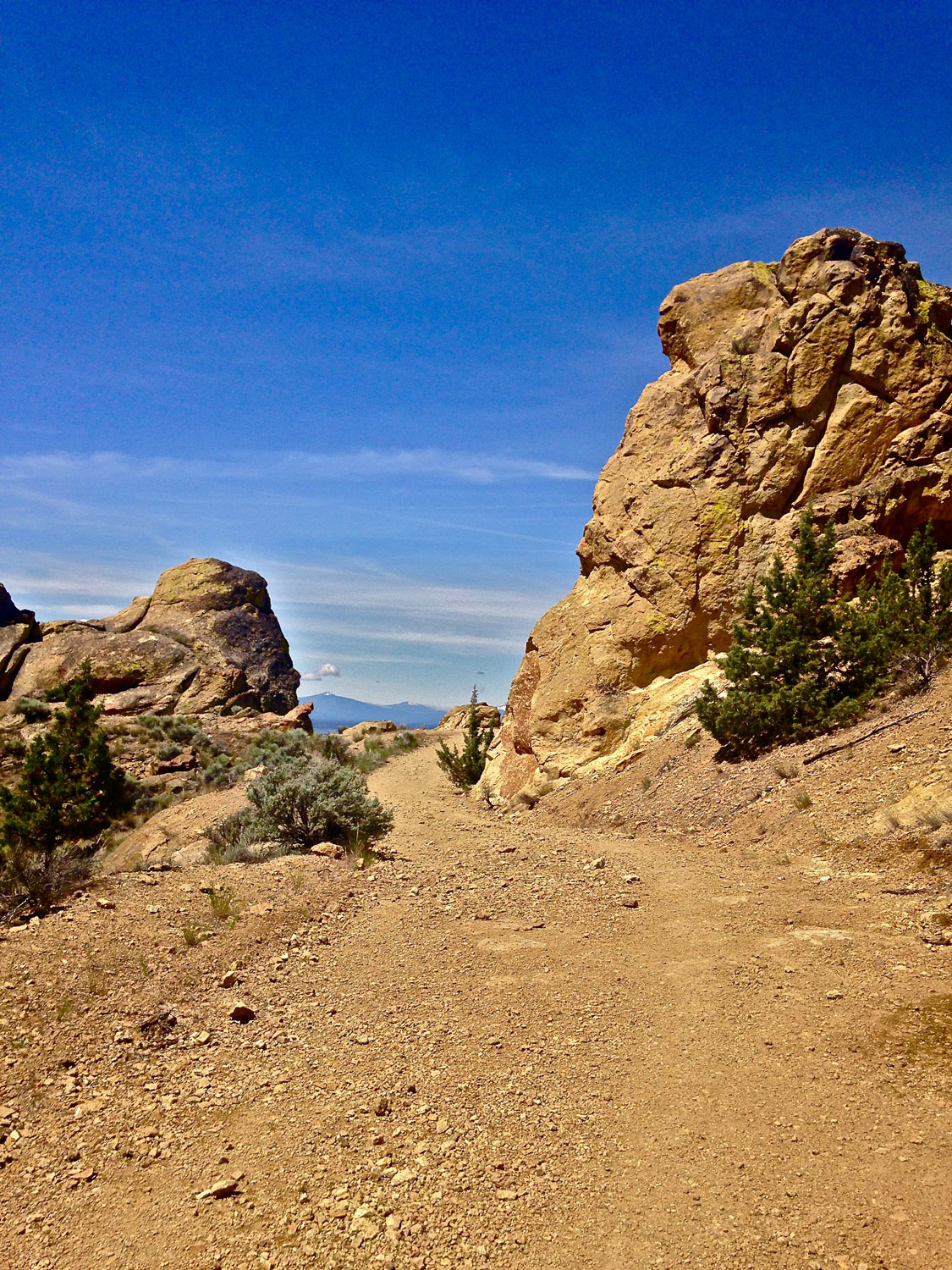 Big rocks mark the final corner to the summit of the Burma Road outside of Smith Rock State Park.
