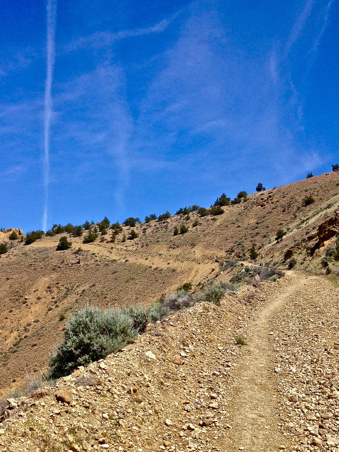 The Burma Road outside of Smith Rock State Park stretches into the distance toward the summit.