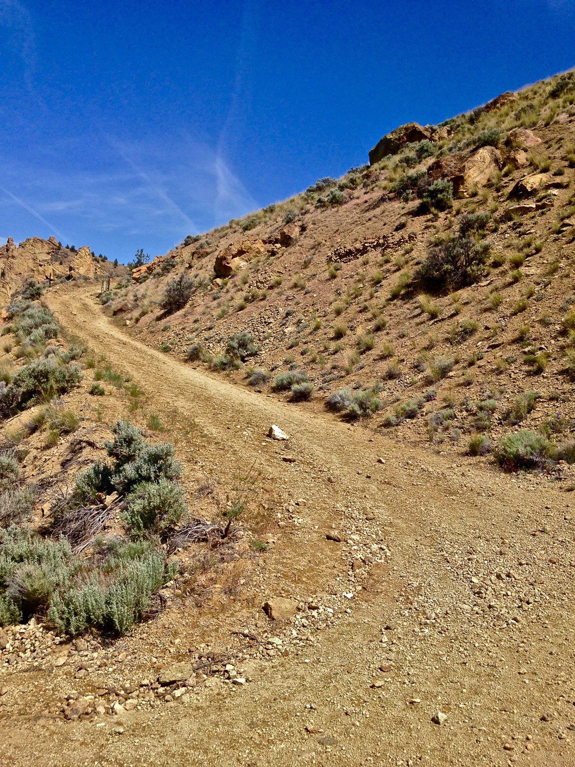 The Burma Road outside of Smith Rock State Park continues to climb in full sun.
