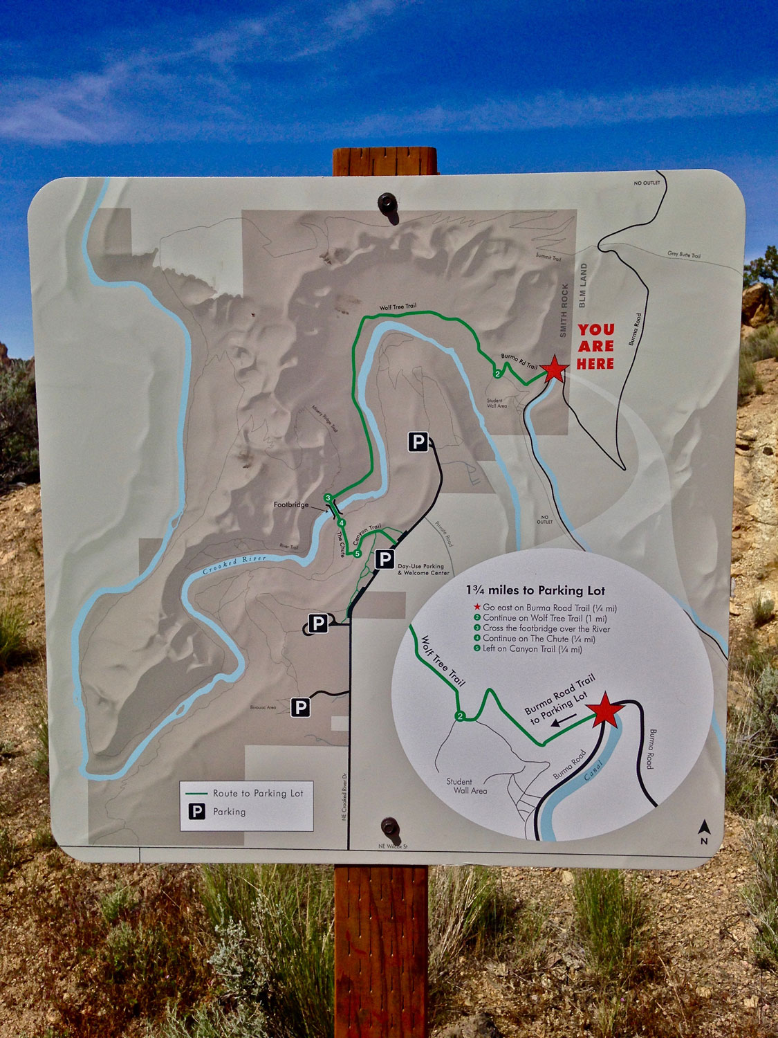 This trail marker at the junction of the Smith Rock State Park and BLM territories shows the way up to the summit.