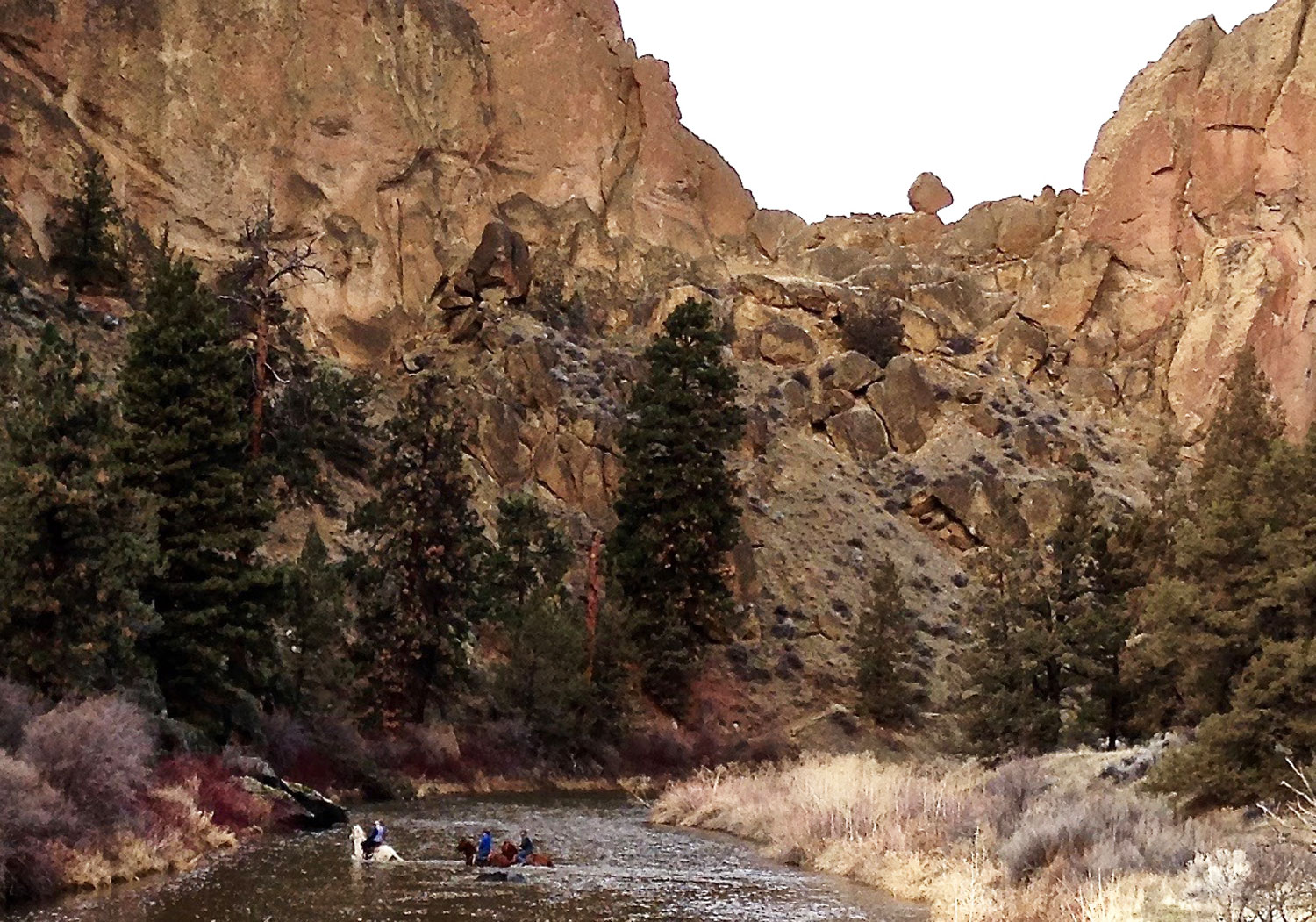 horseback riders crossing the Crooked River from the Canyon Trail at Smith Rock State Park